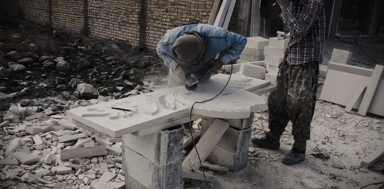 Stenarbetare i arbete